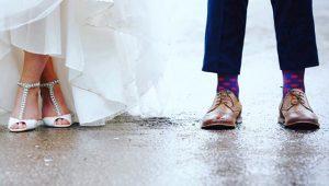 close up of bride and groom footwear