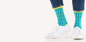 close up of person wearing teal and yellow patterned socks