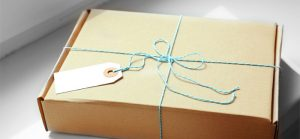 subscription box wrapped in blue string